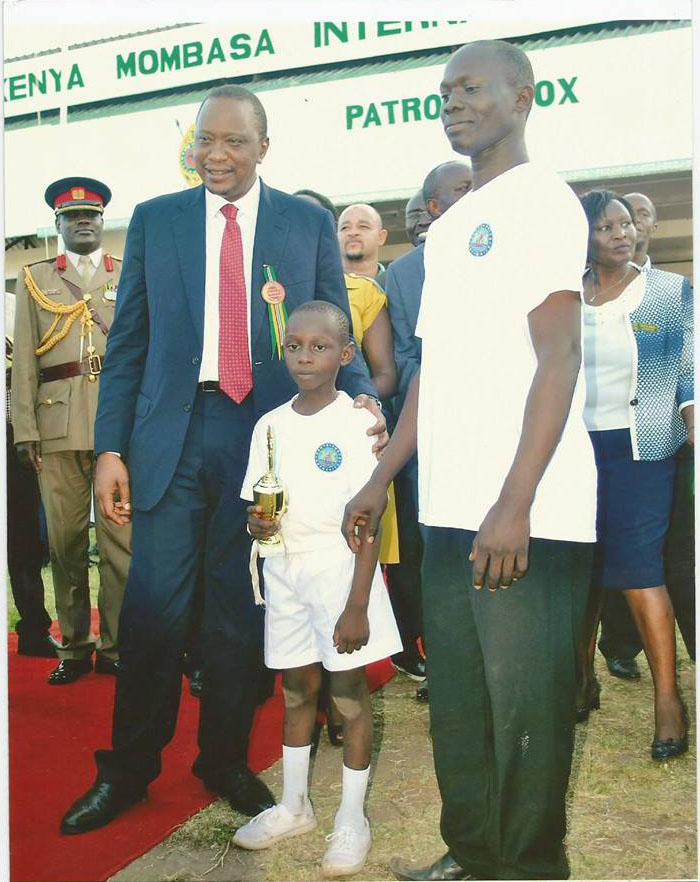 Moses Kebaso winner in Creative Category with H.E the President and Maville Academy Head of School Mr. Donald Owino